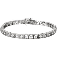 This stunning bracelet for her features an unbroken line of round diamonds. Fashioned in 14K white gold, the 7-inch bracelet has a total diamond weight of 1/2 carats and fastens securely with a tongue clasp.