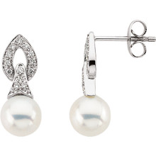 These elegant 14k white gold earrings each feature a 7mm freshwater cultured pearl with diamond accents. Diamonds are 1/6ctw, G-H in color, and I1 or better in clarity.
