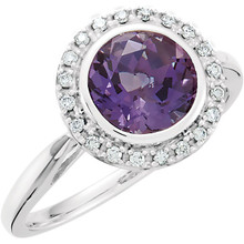 The look of luxury. This statement-making ring features round-cut amethyst encircled with round-cut diamonds (1/8 ct. t.w.).