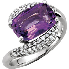 This gorgeous 14K white gold gemstone ring features an 12x8 mm genuine natural cushion-shaped amethyst set in a prong setting accented with beautiful round cut diamonds.