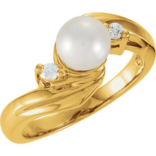 Dress up any outfit with this Akoya pearl ring with two dazzling diamonds on either side of the center white, round pearl. This lovely 14k yellow gold pearl and diamond ring is yet another stunning gift from the sea that everyone will adore.