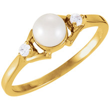 This elegant pearl and diamond ring classes up any ensemble. Seated at the pinnacle of this 14k yellow gold ring is a 5mm white freshwater cultured pearl, which is adorned by two small diamonds. Diamonds are .06ctw, G or better in Color, and I1 or better in Color.