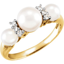 This elegant ring is the perfect choice for day-to-night glamour. Three luminous freshwater cultured pearls is surrounded by sparkling white diamonds in a 14k yellow gold setting.