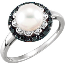A lovely freshwater cultured pearl is encircled with round diamonds in this classic 14k white gold ring for her. The total diamond weight is 1/6 carat.