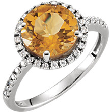 Refined and timeless, this citrine gemstone and 1/6ctw diamond ring fashionably stands out, complemented by 14k white gold.