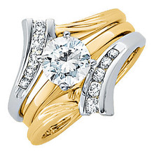 Product Specification  Quality: 14K White/Yellow Gold  Jewelry State: Complete With Stone  Total Carat Weight: 1/4  Ring Size: 06.00  Stone Type: Diamond  Stone Shape: Round  Stone Color: G-I  Stone Clarity: SI1  Width: 16 mm  Weight: 4.60 grams  Finished State: Polished