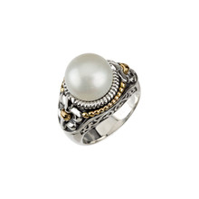 Crafted in sterling silver & 14k yellow gold, this ring features an 11.00 MM round freshwater cultured pearl, Fleur de Lis side accents and rope details.