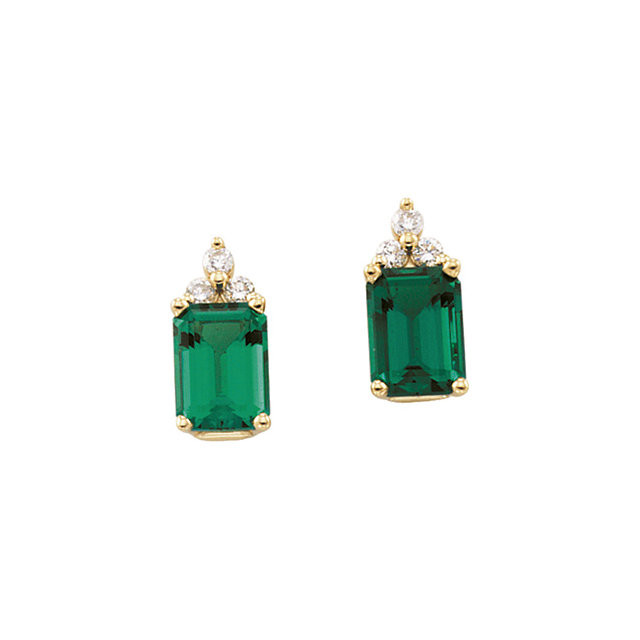 64374c336 These stunning 14k white gold earrings each feature a natural 7x5mm octagon  emerald gemstone with round