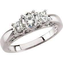 A lifetime of romance is something to celebrate and treasure. honor the past, present and future of your love with a symbolic three stone engagement ring. Dazzling round-cut diamonds brighten the heart of the ring-- each is prong-set for a look of sure brilliance. These magnificent diamonds total 1 1/5 ct. Slip this 14K white gold ring on her finger, and ask her to spend forever with you.