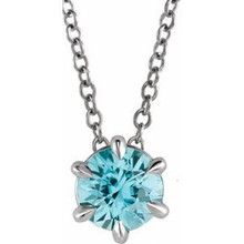 Crafted in platinum, this jewelry has a polished finish for eye-catching design. The necklace features a charming aquamarine gemstone to complete the look.