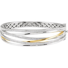 "Versatile and elegant, this beautiful diamond 8"" bangle showcases one carats of brilliant round diamonds set in 14k white/yellow gold."