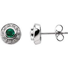 Fashionable and elegant, flaunt the ravishing beauty of these special earrings. Beautifully framed with 1/10 ct. t.w. of dazzling diamond accents, these earrings features two 3.50mm round gemstone emeralds that glisten beautifully. These luxurious 14K white gold posts secure comfortably with friction backs. A thoughtful gift for the May birthday girl.