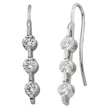 For women who want a unique look, these modern dangling drop diamond earrings showcase a total of 6 brilliant-cut round diamonds set in a single prong setting suspended from lever backs.  These earrings feature graduated diamonds of G-H color and I1 clarity and come beautifully crafted in 14k white gold.