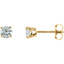 Precious, delicate 14K gold prongs hold twinkling diamonds that sparkle like stars in these diamond solitaire stud earrings. Totaling 1/2 ct., the two diamonds reflect their wearer's refined, sophisticated elegance. These earrings secure with friction backs.