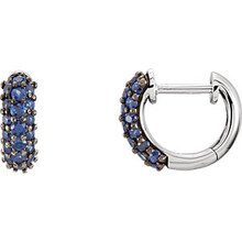 Sapphires prized for their intense velvety color and the calming influence of blue has made it an enduring symbol for loyalty and trust, which also makes it the perfect gift to represent a faithful and steadfast commitment. This colorful hinged hoop design features thirty-eight genuine sapphires prong set in 14k white gold. These small huggie style earrings are approximate 2.5mm in width by 10mm (3/8 inch) in length. Total gemstone weight for the pair is 0.85 carat. Color range varies on all natural stones so please allow for slight variations in shades. Gemstone treatment: natural, not enhanced.