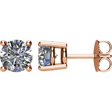Classic and traditional, these diamond stud earrings are a smart anytime look. Created in precious 14K rose gold, each earring showcases a shimmering diamond in a unique miracle setting. Simple yet spectacular, these post earrings are finished with a bright polished shine and secure comfortably with friction backs.