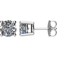 Exceed her expectations with diamonds of tender, elegant beauty. A treasured keepsake, round diamond studs will twinkle for a lifetime. These 2 ctw. round diamond solitaire stud earrings in platinum glisten with a color ranking of G-H and a clarity ranking of SI2-SI3.