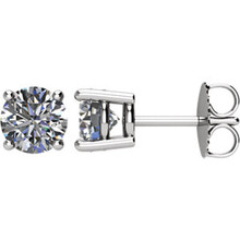 For the unforgettable moments in your life, celebrate with an expression of your love: 1-1/2 ct. t.w. diamond stud earrings. With unsurpassed brilliance, our exclusive diamond offers nearly twice the facets for substantially more sparkle. Straightforward platinum diamond studs for the woman who knows what she wants, whose natural beauty calls for subtle adornment. These beautiful studs close with friction backs.