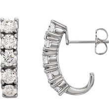 Surprise the woman you love with these 1 1/2 ct. t.w. diamond 5-Stone J-Hoop Earrings. Fashioned in 14K white gold, these linear J-hoop showcase five shimmering round diamonds aligned down each center. Polished to a brilliant shine, these elegant earrings secure with friction backs.