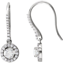 Elegant and extravagant, these earrings are a fabulous look. Beautifully crafted in 14K white gold, each earring showcases a .33 ct. diamond prong-set at the center. A border of smaller round accent diamonds wrap the center stones in a sparkling embrace and also line the earrings settings. Radiant with 1 cts. t.w. of diamonds and polished to a bright shine, these earrings secure with lever backs.