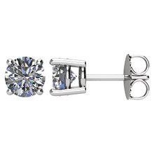 A beautifully matched pair of round brilliant diamonds secured with friction back posts for pierced ears.