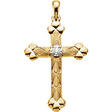 Diamond cross pendant in 14k gold measures 32.00x22.00mm and radiant with 1/10 ct. tw. Polished to a brilliant shine.