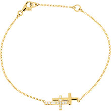 Simple and sweet, this diamond double sideways cross bracelet is a lovely expression of faith. Fashioned in 14K yellow gold, this stylish bracelet is centered with a shimmering diamond-lined sideways cross. Radiant with 1/6 ct. t.w. of diamonds and finished with a bright polish, this 8.0-inch bracelet secures with a spring-ring clasp.