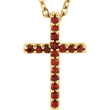 """Prong set with 17 genuine garnet mozambique stones, this Cross Pendant is a lovely symbol of your devotion and faith. Set in 14K yellow gold, the pendant hangs from a 16"""" cable chain."""