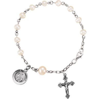 First Holy Communion with Freshwater Pearls Sterling Silver Rosary Bracelet. Features a lobster clasp. Including the Miraculous Mary medal and Crucifix. Great gift for first holy communion recipients in congratulating them on this momentous occasion.
