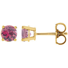 These round genuine pink tourmaline earrings are set in 14K yellow gold. The posts of these fine jewelry earrings are secured by friction backs. Gently clean by rinsing in warm water and drying with a soft cloth.