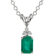 An genuine emerald is topped with three dimonds and set in 14k white gold. This beautiful necklace is great to wear alone or as a layered look.