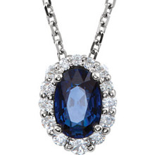Sparkling round diamonds surround a striking natural sapphire in this classic necklace for her. Additional diamonds decorate the bale. Fashioned in 14K white gold, the pendant, with a total diamond weight of 1/6 carat, suspends from an 18-inch chain that fastens with a spring ring clasp. This necklace is not enhanced.