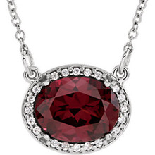 This 14k white gold pendant is perfect for everyday wear! The pendant features a oval 09.00x07.00mm garnet gemstone surrounded by 20 round cut diamonds. An 16 inch solid cable chain is included.