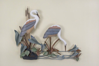 Hand carved herons.