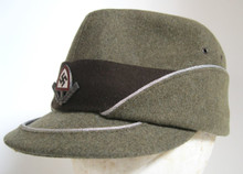 WW2 German Reichsarbeitsdienst (Labor Service) Officers 'Robin Hood' Cap. Most NCO and other ranks' caps are of pressed felt, but this one is made in a four-piece crowned heavy wool 'Uniformtuch' as is typical of officers caps. The quality of the hat is extremely good and it has the distinctive side air-vents, basket-weave aluminum piping with a dark wool brown cap band with a high quality Assmann-made, enameled RAD officers quality cap badge affixed. The  cloth and enamel badge are as typical for a service cap as opposed to a dress cap made of Trikot with Bullion insignia.
