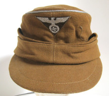 German RMBO (Eastern Ministry for Occupied Territories) M-43 Style Cap. This very rare hat, worn by governing officials of German occupied Poland and other eastern territories, features silver bullion crown piping indicating the rank of a lower rank official.