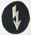 "WW2 German Army Infantry signals sleeve ""Blitz"" Patch. A lightening bolt embroidered in white rayon thread on a dark blue green cotton mesh material. Late war variation."