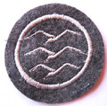 "WW2 German Luftwaffe DLV-Deutsche Luftsport Verband (German Air Sports Association) Glider Pilot Proficiency Badge ""C"" Class. Machine embroidered single gull in white cotton thread on Luftwaffe blue/gray wool."