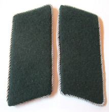 "WW2 German SS Schutzmannschaft or Auxiliary Police EM Collar Tabs, Pair. The Schutzmannschaft or Auxiliary Police (literally: ""protection team, abbreviated as Schuma) was the auxiliary police of native policemen serving in those areas of Eastern Europe occupied by Germany during World War II."