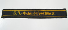 "This short (5"" long) cuff title, ""H.J.=Gelandessportwart"" (HJ Field Exercise Warden) is machine woven in golden yellow on a black band."