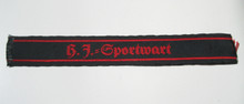 "This short (5"" long) cuff title, ""H.J.= Sportwart"" (HJ Exercise Warden) is machine woven in red on a black band."