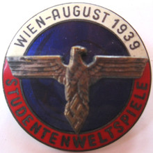 "Original German NSDStB Studentweltspiele-Wien 1939 (International University Games) Enameled Event Badge. Measuring 1 9/16"" in diameter, the badge is made of two piece brass and nickel construction with a three tone fired enamel finish with inset eagle."