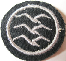 "WW2 German Luftwaffe / NSFK Glider Pilot Proficiency Badge ""C"" Class. Machine embroidered single gull in white cotton thread on Luftwaffe blue/gray wool."