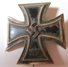 """WW2 German Iron Cross First Class, 1939, Hand Vaulted. 1939 pattern, die struck, three piece, iron and alloy construction Pattée style cross with a single piece iron core and a two piece alloy frame. The obverse features an embossed, high relief, central, canted, swastika with the re-institution date, """"1939"""", to the bottom arm."""