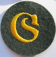 WW2 German Army Equipment Administration NCO Sleeve Patch, Felt. Sone of the backing are a darker blue-green than others.