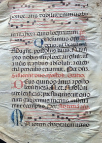 "M1154 A genuine leaf from an Antiphonal, in Latin, on vellum.  Five-line staves and rubrics in red and text in a gothic hand in dark brown ink.  Large initials alternate in red and blue.  Large initial ""M"" opens a text from John 15:14, ""Maiorem caritatetm…"" (You are my friends….)  Some water damage evident.  Spain, c. 1580.  Size: 16 ¼ x 12 inches.  Mat size: 16 x 12 inches."