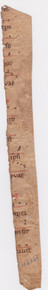 """M6362 Long strip from an early musical manuscript, Italy c. 1100  Long thin strip from an early choirbook, with openings of 14 lines set below music arranged around a single red clef line, red rubric and small initial, one fine Romanesque initial """"B"""" formed of delicate red bands and with upper and lower compartments not touching a closest points.  270 x 28 mm."""