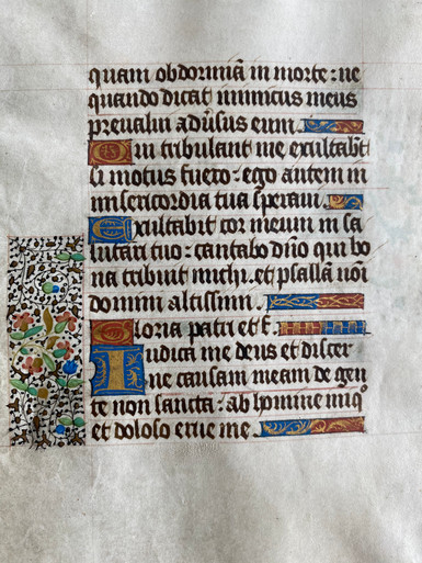 """M5555 Single Leaf from a Book of Hours,Hand-illuminated in tempera and gold,Normandy, c. 1475  This is a genuine leaf from a Book of Hours which was written by hand in the 15th c.  Latin text written in a gothic hand in dark brown ink.  Ruling in red.  Versal initials in liquid gold on a ground of blue or rust with gold tracery.  Line-endings of the same decoration.  An exquisite border of leaves in gold leaf on ivy vines with fronds and flowers in tempera.  Initial """"U"""" on recto opens Psalm 13 and initial """"T"""" on verso opens Psalm 43."""