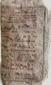 M6591 Cutting of from an early French Choirbook, recovered from a binding,c. 1220  Cuttingwith music on a 4-line pale red stave, remains of red initial and rubrics, contemporary folio no. '.40.' at head of one side.Very fine example of early notation. Size: 9 1/4 x 5 inches.