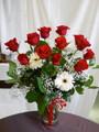 dozen roses arranged
